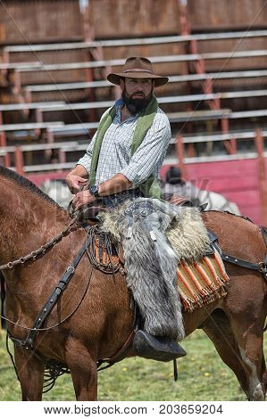June 10 2017 Toacazo Ecuador: local cowboy on horseback wearing alpaca chaps in the rodeo arena