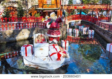 Greece, Drama - December 14, 2016: Santa Claus figurine at greek Christmas market in Drama, Greece