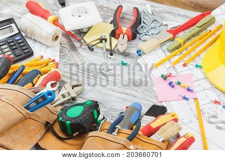 Drawings, Yellow Helmet And A Construction Belt With Different Construction Tools