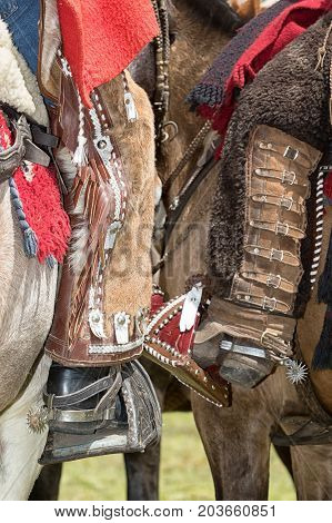 June 10 2017 Toacazo Ecuador: foot of local cowboys equipped for rodeo with chaps and spurs