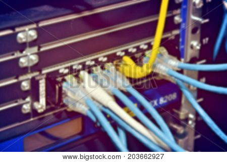 Blurred Image Of Severs Computer In A Rack At The Large Data Center.