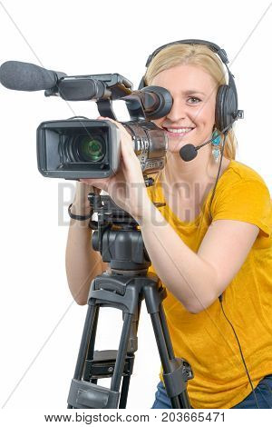 a blond young woman with professional video camcorder on white