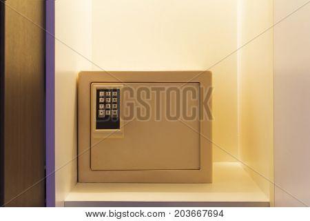 safe box hidden in low light wardrobe.