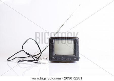Small vintage black and white television on withe background