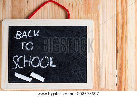 Back to school written on a blackboard. Copy space on the right.