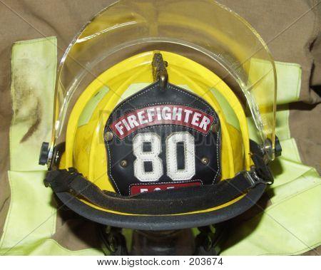 Firefighter Helmet On Burnt Jacket