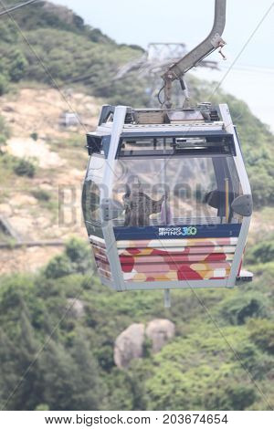 Hong Kong - September 12, 2010 : Ngong Ping 360 cable car carry tourists to top of the hill