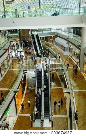 Shopping Mall With Shoppers In Singapore