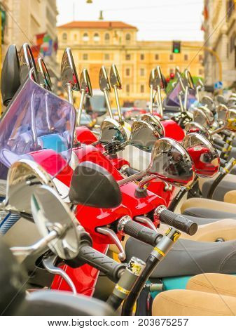 ROME, ITALY - AUGUST 30, 2013: Row of scooters on the street of Rome. Rome, Italy