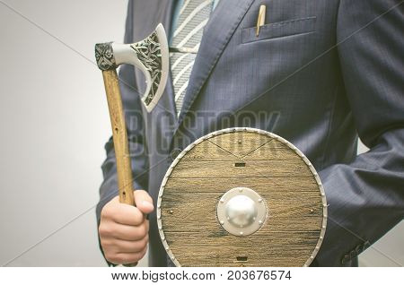Insurance agent. Security agent. Business investment protection. Save your money. Business man with toy axe and shield in hands.