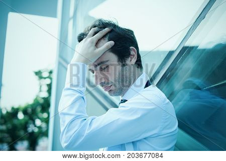 Desperate And Stressed Businessman Feeling Bad