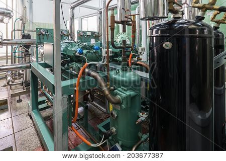 Industrial refrigeration compressor unit. Abstract industrial background.