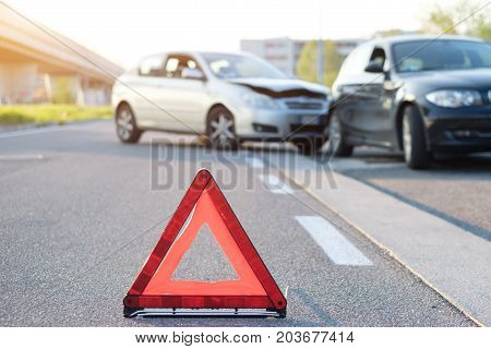 Reflective red triangle to point out a car crash