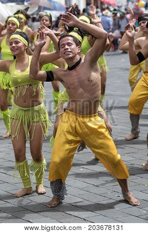 June 17 2017 Pujili Ecuador: young dancers in bright color costumes at Corpus Christi festival