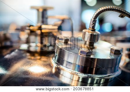 Metal flanges with flexible nipples. Abstract industrial background.