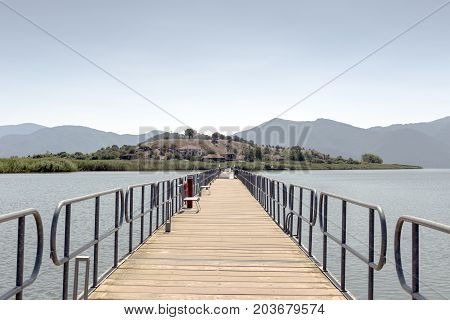 Panorama of a mountain lake Small Prespa in nom Florina and islet of Saint Achilles (Macedonia, northwest Greece)