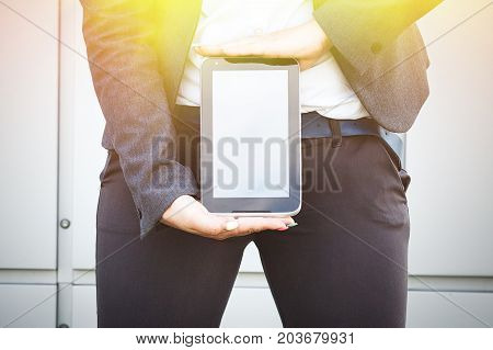 Business Concept Of Success And Negotiation. A Woman Boss, In A Suit And Glasses, Shows A Tablet At