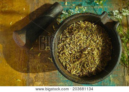 Cumin Seeds In Cast Iron Mortar