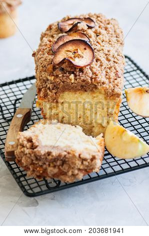 Apple Cinnamon Streusel Cake On A Wire Rack On A White Stone Background. View From Above.