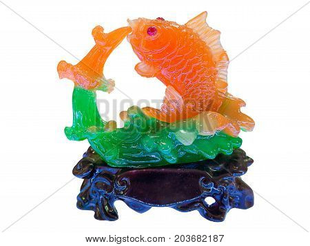 Fish figurine made of jade isolated on white background.
