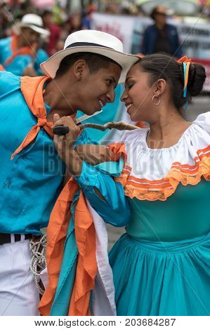 June 17 2017 Pujili Ecuador: male and female dancers closeup at the Corpus Christi festival