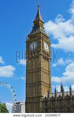 LONDON, UNITED KINGDOM - MAY 9: Big Ben with the London Eye in the background on May 9, 2011 in London, United Kingdom. London Eye is the tallest Ferris wheel in Europe at 135 meters