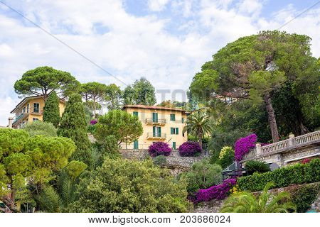 Beautiful daylight view to a house on mountains near trees and blue sky. Santa Margherita Ligure city, Italy