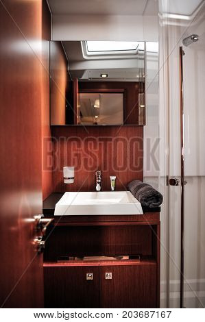 basin in restroom. Decoration of restroom with wooden theme.