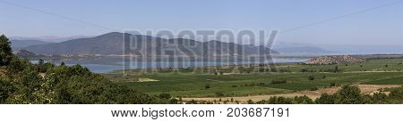 Panorama of a mountain lake Small Prespa in nom Florina on a sunny day (Macedonia, northwest Greece) poster