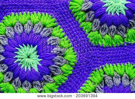 green and blue Knitted textile carpet pattern macro.