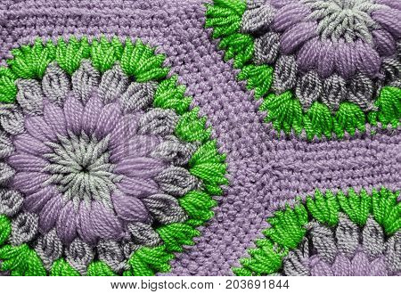 grey and green Knitted textile carpet pattern macro.