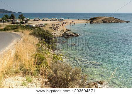 CHALKIDIKI, CENTRAL MACEDONIA, GREECE - AUGUST 25, 2014: Seascape of Tristinikouda beach at Sithonia peninsula, Chalkidiki, Central Macedonia, Greece