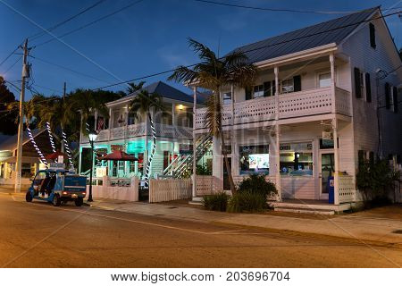 KEY WEST, FLORIDA, USA - JAN 18, 2017: Shops, bars and hotels in the twilight at Duval street in the center of Key West
