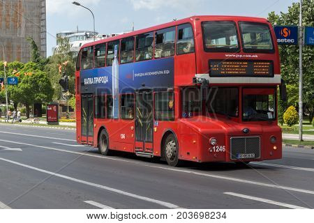 SKOPJE, REPUBLIC OF MACEDONIA - MAY  13, 2017:  A red double-decker bus passing through the streets of city of Skopje, Republic of Macedonia