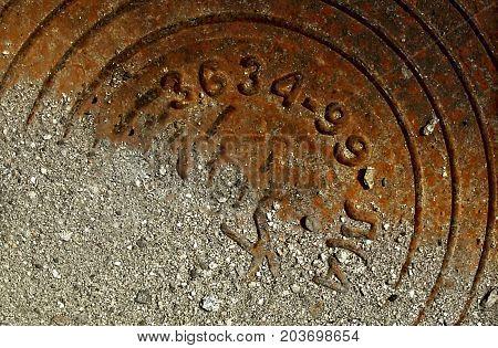 Manhole. Rusty manhole cover. Rusty manhole. Grunge background. Manhole.