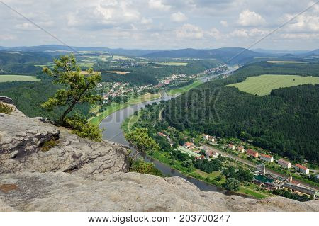 The view of the Elbe and the far-away landscape in Saxon Switzerland