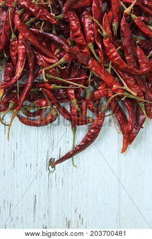 Red Dried Chilly On White Wooden.