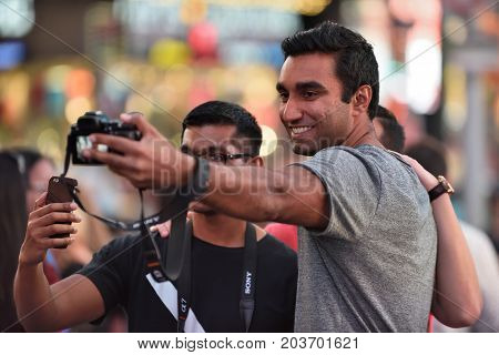 NEW YORK CITY USA - AUG. 26 : Unidentified people on the Times Square in Manhattan on August 26 2017 in New York City NY. Times Square is a major commercial intersection tourist destination and entertainment center in NYC.