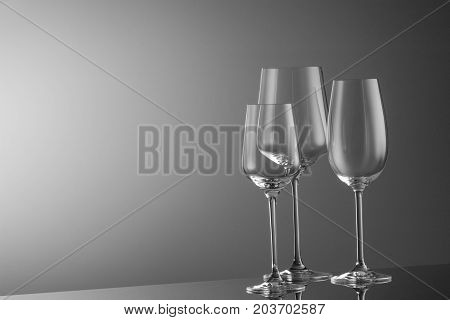 several empty wine glasses on a light background