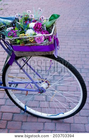 a karzin with flowers on a bicycle close-up
