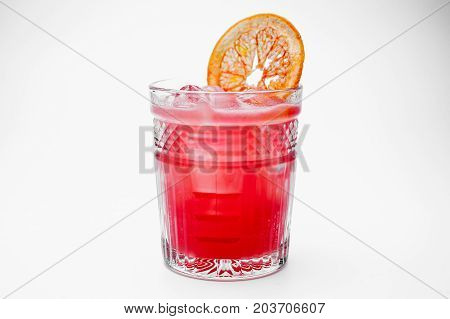 Fresh pink cocktail decorated with a slice of grapefruit isolated on white background
