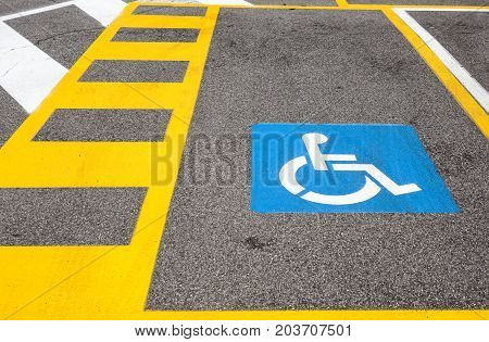 parking space reserved for handicapped shoppers in a retail parking lot