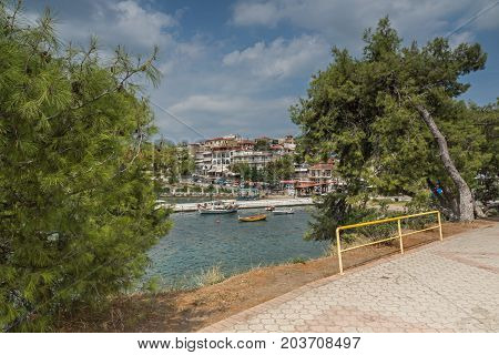 CHALKIDIKI, CENTRAL MACEDONIA, GREECE - AUGUST 25, 2014: Panorama of Coastline of town of Neos Marmaras at Sithonia peninsula, Chalkidiki, Central Macedonia, Greece
