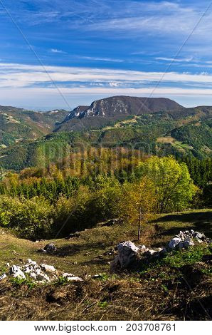 Viewpoint on a landscape of mount Bobija, peaks, hills, rocks, meadows and colorful forests, west Serbia
