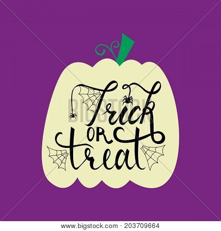 Trick or treat modern brush inscription on pumpkin. Illustrated phrase for Halloween.