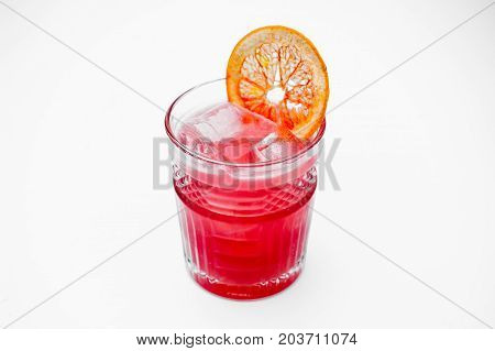 pink cocktail decorated with a slice of grapefruit isolated on white background