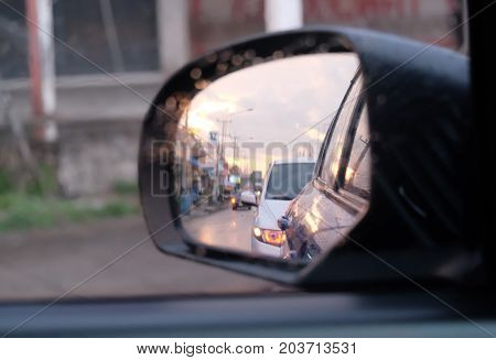 The reflection of the rearview mirror of the car.