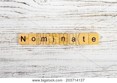 NOMINATE word made with wooden blocks concept