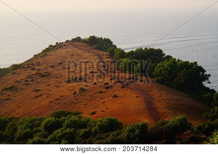 Road to the edge of the hill, view from above, Chapora hill, Goa, India