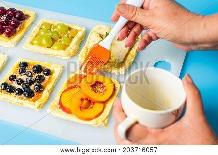 Chef Applying Egg On The Fruit Sweet Pie